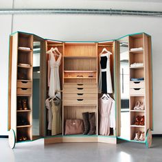 compact walk in closet by Designer Hosun Ching. He created the Walk-In Closet for his graduation project. The smart wardrobe opens out into a mini-fitting room, complete with mirrors to view your outfits from every angle.