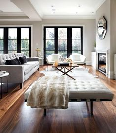 oak floors, tufted leather seating + industrial black window panes...