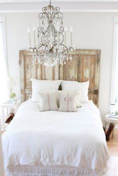 White Bedroom: Rustic Door Headboard and Fabulous Chandelier Simple, so easy, with a fantastic wool rug, would be very cozy.  No boys allowed near the white bedding, of course.