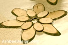 Yesterday I shared with you my new, larger more varied and complex wood slice flowers . I did take photos as I created these to share with y. Wood Log Crafts, Wood Slice Crafts, Small Wooden Projects, Diy Wood Projects, Woodworking Projects Diy, Woodworking Wood, Tree Branch Crafts, Wooden Flowers, Outdoor Crafts