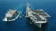 Nimitz-class aircraft carrier USS Dwight D. Eisenhower (right),  fast combat support ship USNS Arctic (T-AOE 8) (right)