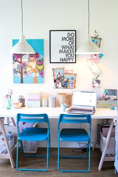 Using a rectangular table as your desk and great pendant lighting, creates an office space to work in.