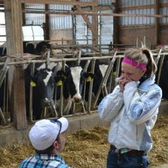 What a cute proposal. She walks in to feed her animals in the barn, lined with rose petals every where, and he proposes!! Adorable <3