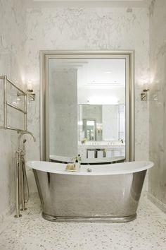 Bath. Free-standing polished nickel tub. Towel warmer. Mirror. Marble mosaic floors.