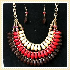 HOST PICK!NWT Tribal Statement Necklace Set Red, ivory and burgundy statement necklace and earring set with iridescent accents. BOUTIQUE Jewelry Necklaces