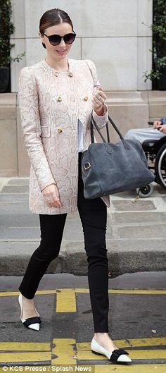 Miranda Kerr in Stella McCartney snakeprint  print coat and Miu Miu flats for Paris #fashionweek Spring 2014 fashion shows