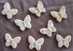 white and gold wedding butterfly cookies.