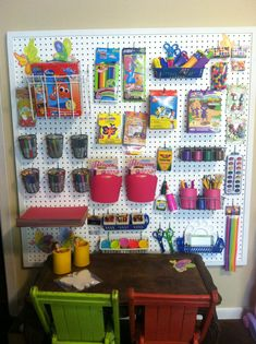 This is an art/craft wall my husband and I created for our 3 year old twin grandaugters.  They love it and love working on art projects...peg board, hooks, buckets, shelves etc.  hours of fun...add to the board with new finds...