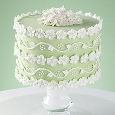 Beautiful Blossoms Cake - The apple blossom's promise of good fortune encircles this truly dimensional cake.  Present it on a pedestal cake plate for an impressive display.