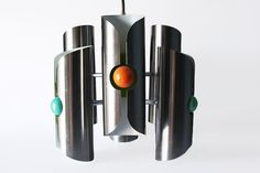 Great pendant designed by Dutch Manufacturer RAAK in the 60s-70s.  Collectible.  Condition: excellent  Material:chromeComes without the bulbs.  Ø40cm