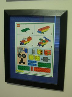 Lego Wall Art. Frame instruction sheets and line them up on the wall.