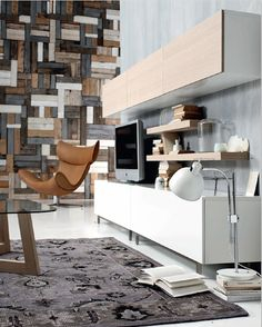 Love the wooden wall, love the brown chair, love the painted rug. Just L.O.V.E the whole space.