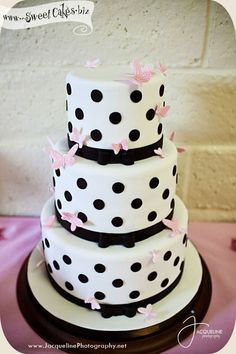 3 tier white cake with black polka dots and pink butterflies. Love it!