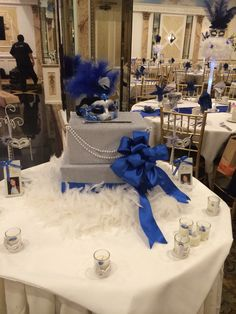 Masquerade theme card box . Royal blue, silver . Feathers with boas . Sweet 16 Masquerade, Masquerade Theme, Masquerade Wedding, Masquerade Ball, Masquerade Outfit, 40th Birthday Parties, 50th Birthday Party, Anniversary Parties, Masquerade Party Centerpieces