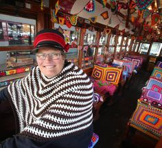 COLOURFUL: Tram driver Julie Cain said the tram's new decor was brilliant and got into the spirit by wearing a woollen shawl. Picture: PETER... .... Bendigo Woollen Show July 2014 * <3