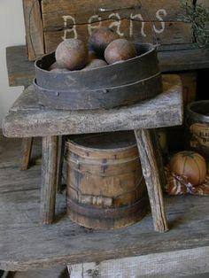 old stool, wood firkin and sieve full of primitive belani apples!