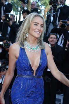 Sharon Stone walking the red carpet at the premiere of Behind the Candelabra in a de GRISOGONO High Jewellery white gold necklace featuring seven cabochon emeralds and white diamonds #Cannes2013