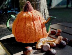 Gorgeous pumpkin tea cosy, from Buttons And Beeswax (http://buttonsandbeeswax.com/patterns/free-knitting-patterns/halloween-pumpkin-tea-cosy/.  The pattern PDF is free.