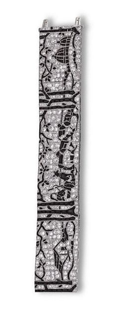 ART DECO DIAMOND AND ONYX 'RUSSIAN WINTER' BRACELET, CIRCA 1925.  The articulated band decorated with buff-top calibré-cut onyxes depicting three scenes from a Russian winter, including a country cottage, a shepherd and his dog at rest guarding a flock of sheep, and a Russian church, the scenes separated by trees with outstretched branches, within a ground of old European-cut and single-cut diamonds, mounted in platinum, length 7 1/8 inches.