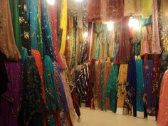Kurdish fabric store...I want the orange and the turqoise with the contrasting embroidery on the left