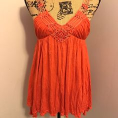 Free People Beaded Top Awesome top!  Bright orange with beaded details on the shoulder straps, all beads appear to be there, they are orange stones. Gently worn a few times.  This is an amazing top for summer!  Love the color!  The tiny metal tag has fallen off on the inside, the size tag remains, and I know this is from FP, as it's very much that style and quality, and the size tag matches theirs.  Slight asymmetrical hem. Free People Tops