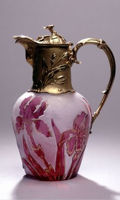 Cased Glass Silver gilt Claret Jug: The cameo red & white glass cut with flowering Irises is signed by Daum, Nancy, Origin: America/France, 1900
