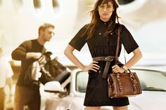 An ad visual from the MICHAEL Michael Kors fall 2015 campaign featuring Karmen Pedaru and BenjaminEidem.