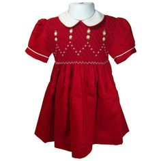 """Victoria (Red) - Traditional smocked dress with embroidery overlay.  Styled with short """"cuff"""" sleeves and """"Peter Pan"""" collar. Button fastening at the back, with matching fabric """"ribbons"""" to tie a bow.  Fabric piping to collar and cuffs to compliment embroidery. Available in sizes 6 months - 8 years."""