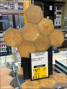The Honeycomb shape, grouped-hexagon of this Tile offering is used to help attract attention by displaying the tile upright silhouetted… Honeycomb Tile, Honeycomb Shape, Silhouette Sign, Porcelain, Retail, Tiles, Shapes, Display, Color