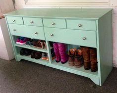 Old dresser painted and turned into a shoe rack and hat and mitten storage for an entry or mudroom