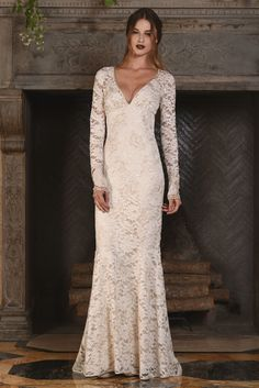 """Claire Pettibone """"Amber"""" Dress: Long sleeved lace wedding dress with deep v-neckline. 