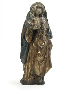 A PARCEL-GILT POLYCHROME CARVED OAK FIGURE OF MARY MAGDALENE -  NORTH GERMAN, EARLY 16TH CENTURY
