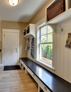 One important place to add storage space is your mudroom. If you don't have a mudroom, consider adding shelving and a long bench to the wall next to your entry door.
