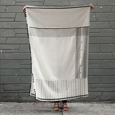 This cotton throw features minimalist black and white woven patchwork patterns, hand-spun and handwoven according to 4000-year-old traditions. Shop Home Textiles on DARA Artisans, a sophisticated marketplace for handmade crafts.