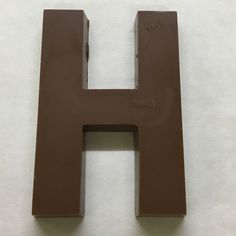 The letter H made of milk chocolate.