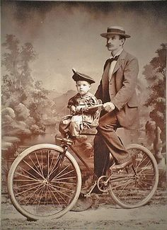 Vintage photograph father riding child on bicycle Summertime bike ride in the good old days