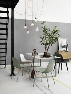 Simple design. Consists of open space and grey and white walls, makes a clear and airy feeling.