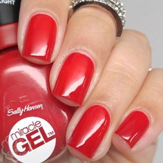 Rhapsody Red by Sally Hansen Insta-Dri Collection. Full review and more swatch photos available on my blog ManicuredandMarvelous.com.  #nail #nails #nailpolish #polish #swatch #polishswatch #sallyhansen