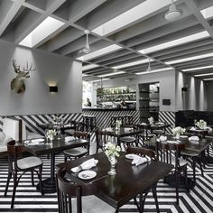 Mexico City, the Anzures neighbourhood- The dominating feature is the striped floor, whose chevrons, along with some unfortunate former wildlife hung and perched on the walls, brings a certain safari vibe to the party...