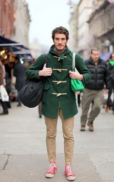 Shop this look for $20:  http://lookastic.com/men/looks/dark-green-duffle-coat-and-khaki-chinos-and-red-high-top-sneakers/3567  — Dark Green Duffle Coat  — Khaki Chinos  — Red High Top Sneakers