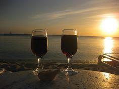 Drinking wine on the beach at sunset
