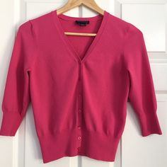 """Ann Taylor Sweater Set On Wednesdays we wear pink! Gorgeous AT v-neck sweater set prebundled to save shipping. Machine washable (!) rayon/nylon blend. Cardigan: sleeves measure approx 11"""" and in front it measures approx 20.5"""" from shoulder seam to bottom of hem. Sorry no trades or PayPal. Note: I'm poshing this for my Mom. Her home is  free but does have a . Thanks for shopping by! Ann Taylor Sweaters"""