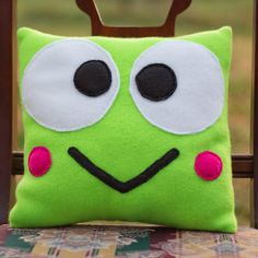 So darn cute http://www.etsy.com/listing/92756173/sanrio-keroppi-fleece-pillow