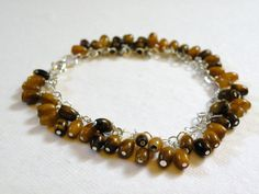 Eye Of The Tiger      Natural Tiger Eye by ScorpionMoonDesigns, $75.00