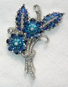 VINTAGE LARGE MAZER FLOWER SHAPED BROOCH WITH BLUE & CLEAR GLASS RHINESTONES  sanfordsfinest (seller) e-bay.com