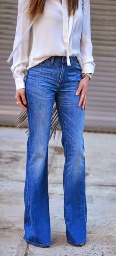 try a white silk blouse, high waisted, medium wash flare leg jeans and a ring. simple and boho-chic