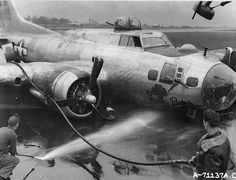 """B-17G """"Lucky Patch"""" of the 527th Bomb Squadron, 379th Bomb Group, 8th Air Force crash lands with wheels up."""