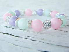 Pink, aqua and purple mountain jade surrounded by clear crystal pave beads and clear rhinestone spacer beads.  This stretch bracelet is perfect for Easter $34.50
