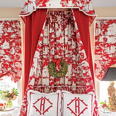 Great Quadrille print with red & white monogrammed shams.