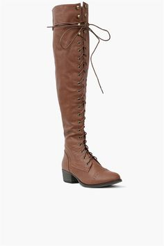 Tan Boots - these are a super cool rendition of the staple riding boot. These over-the-knee lace up boots have a faux leather exterior. Wear this awesome pair with jeans and an over sized sweater for the ultimate fall or winter look.